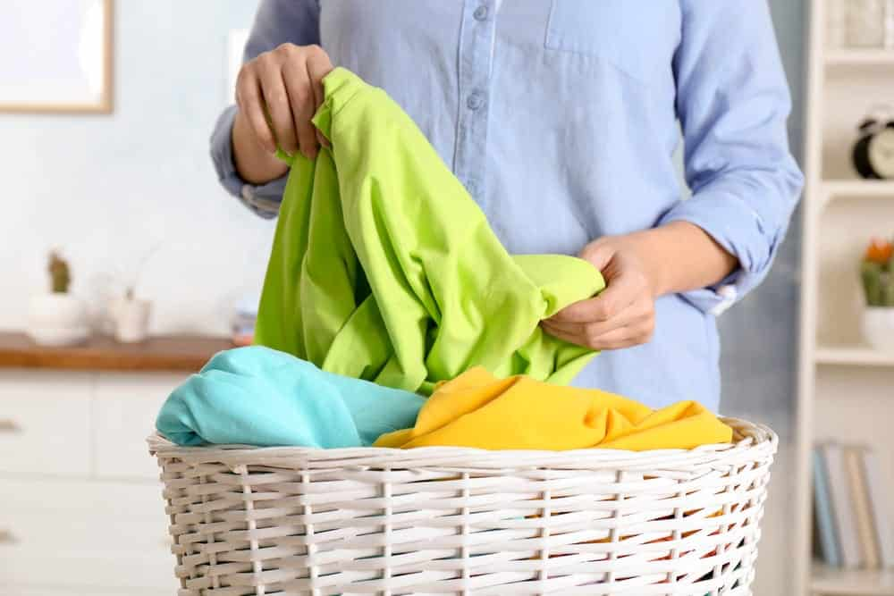 Woman sorting laundry, indoors