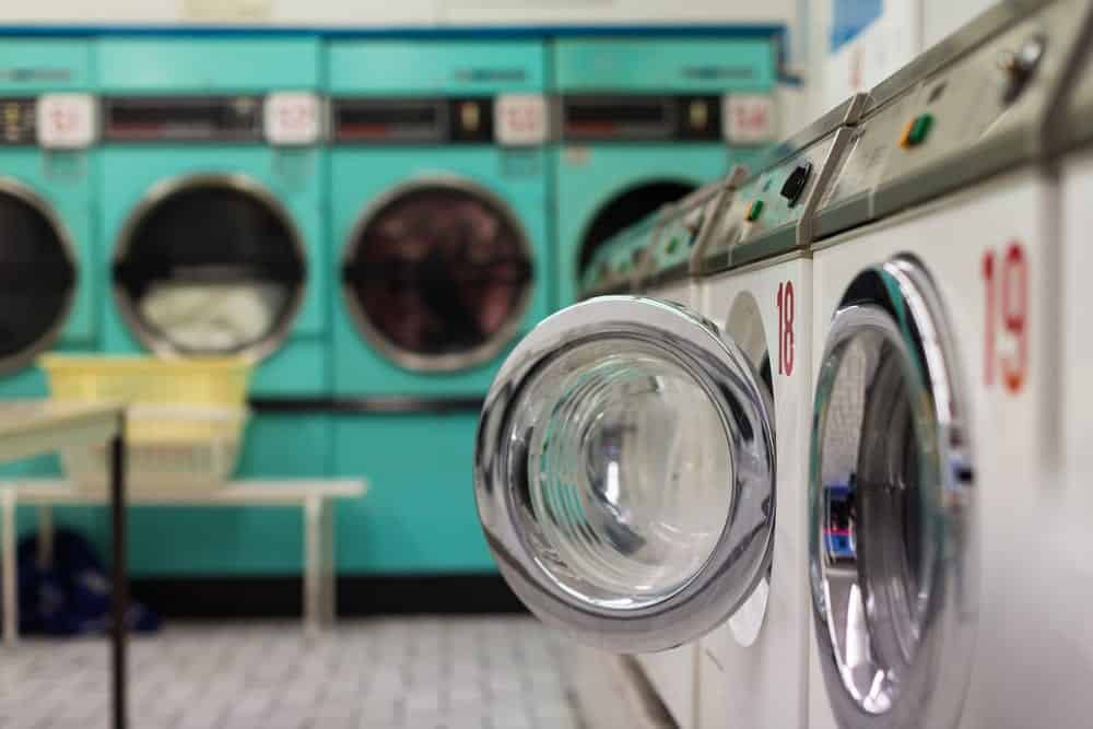 Row of washing machines and dryers